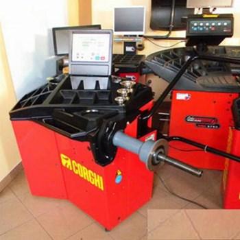 Thiết bị cân bằng lốp tự động EM 7440